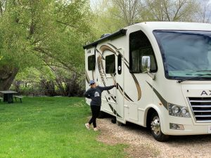 Rachel standing next to the Axis RV